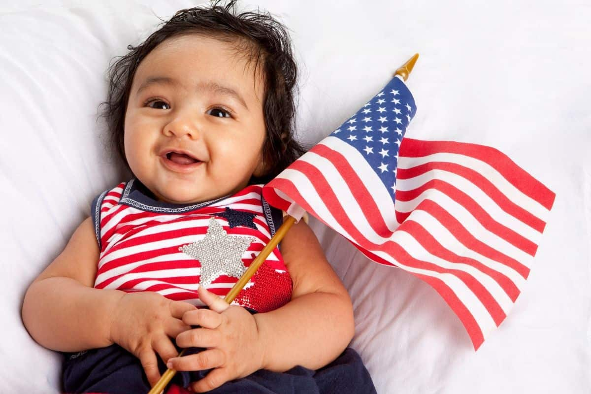 american baby holding flag