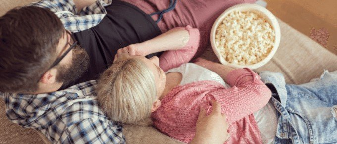 couple watching movie with popcorn