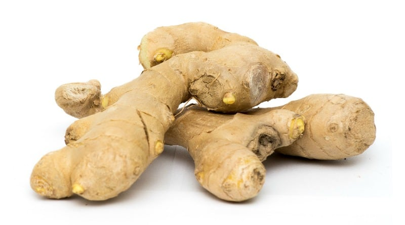 2 pieces of fresh ginger on a white surface