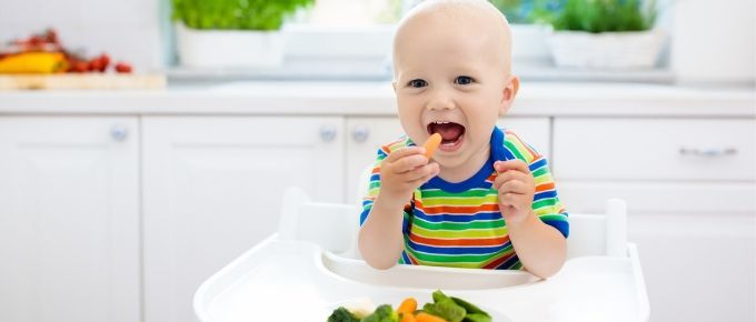 baby eating healthy food