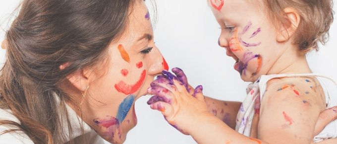 mom and baby playing with paint