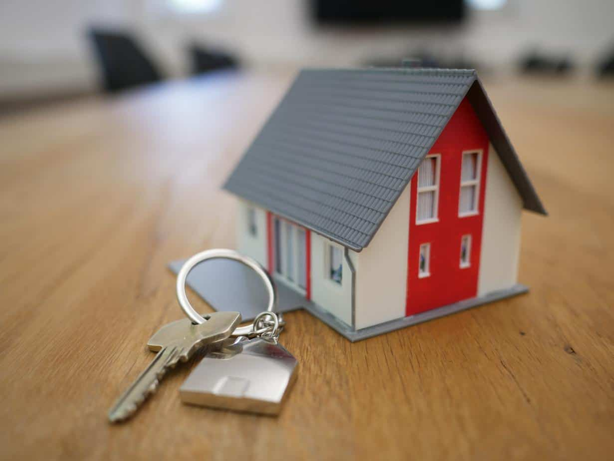 miniature model of a home with keys in front
