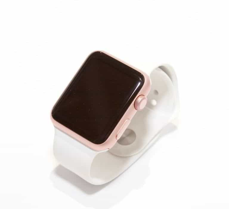 photo of an apple watch with a white band