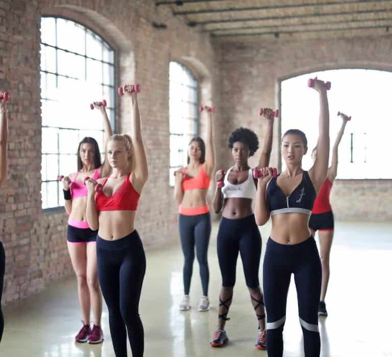 group of women doing weight training in a room