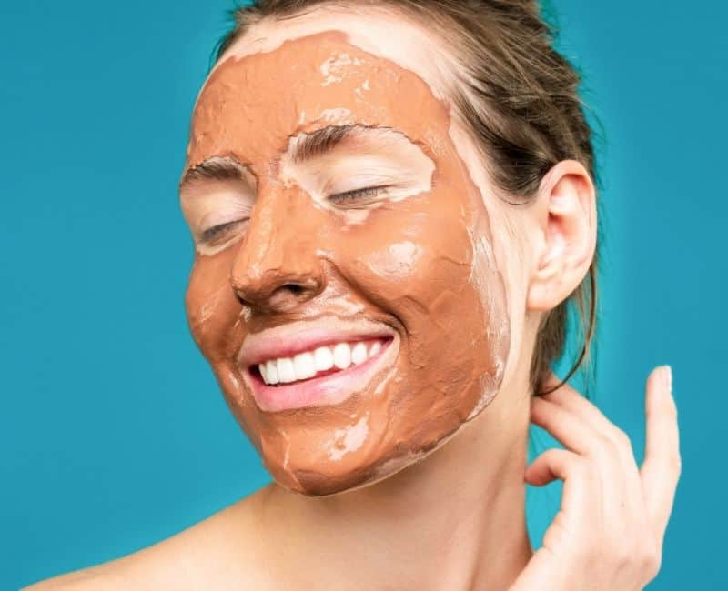 woman with a clay mask on her face
