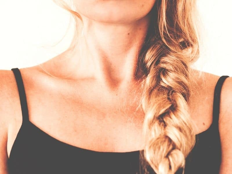 woman with a braid over her front shoulder facing the camera