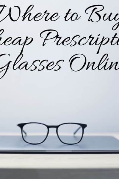 a pair of glasses on a closed laptop on a table
