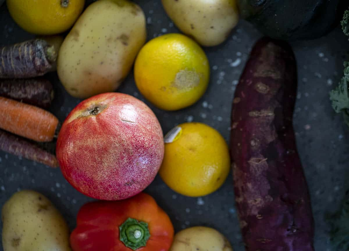 fruit and vegetables laying on a countertop
