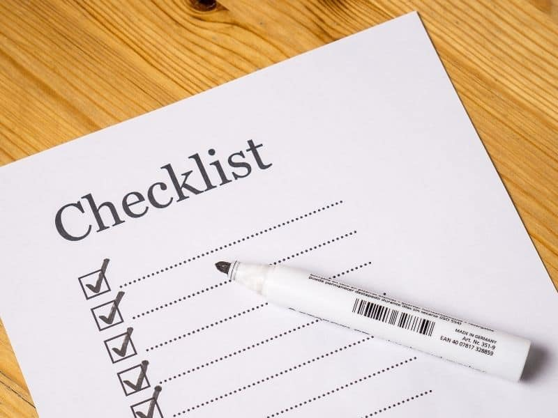a checklist sitting on a table with a pen