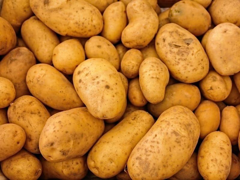 a pile of whole potatoes