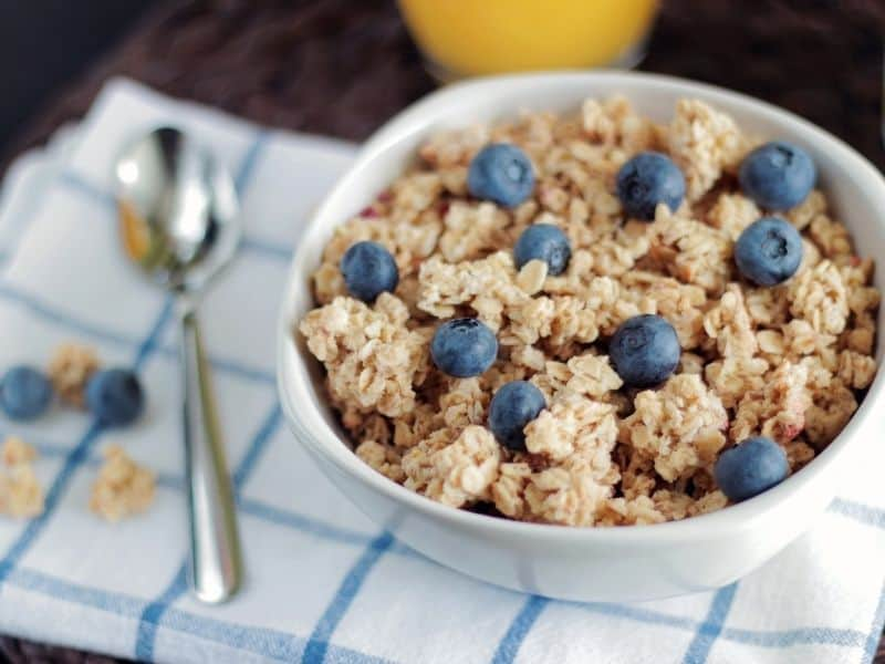 a bowl of oatmeal with blueberries on top