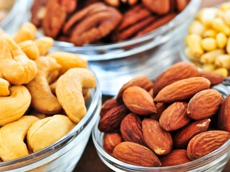 bowls of almonds, cashews and pecans