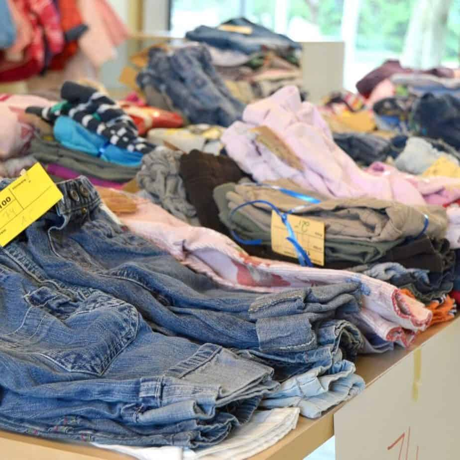 used clothes for sale on a table