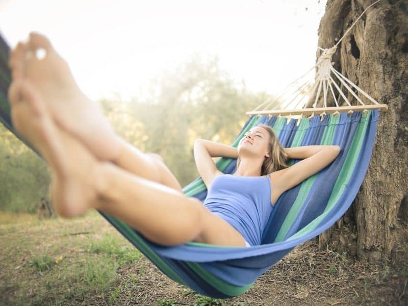 a woman laying in a hammock