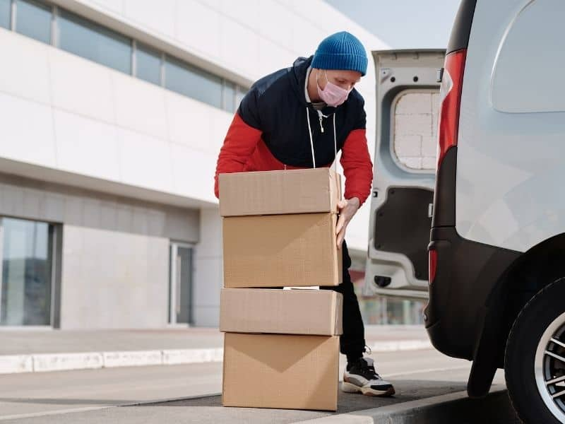 a man picking up packages to put on a truck
