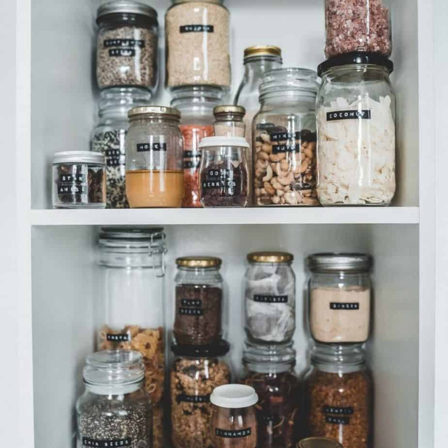 glass jars filled with food items on shelves