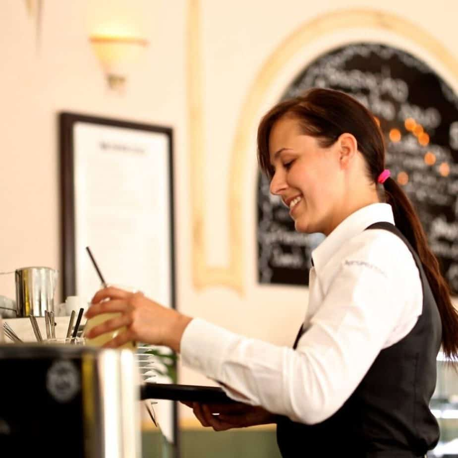 a waitress at the wait station smiling
