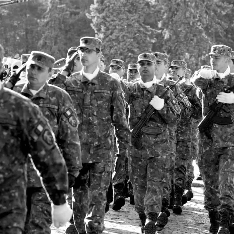 military men in uniform marching