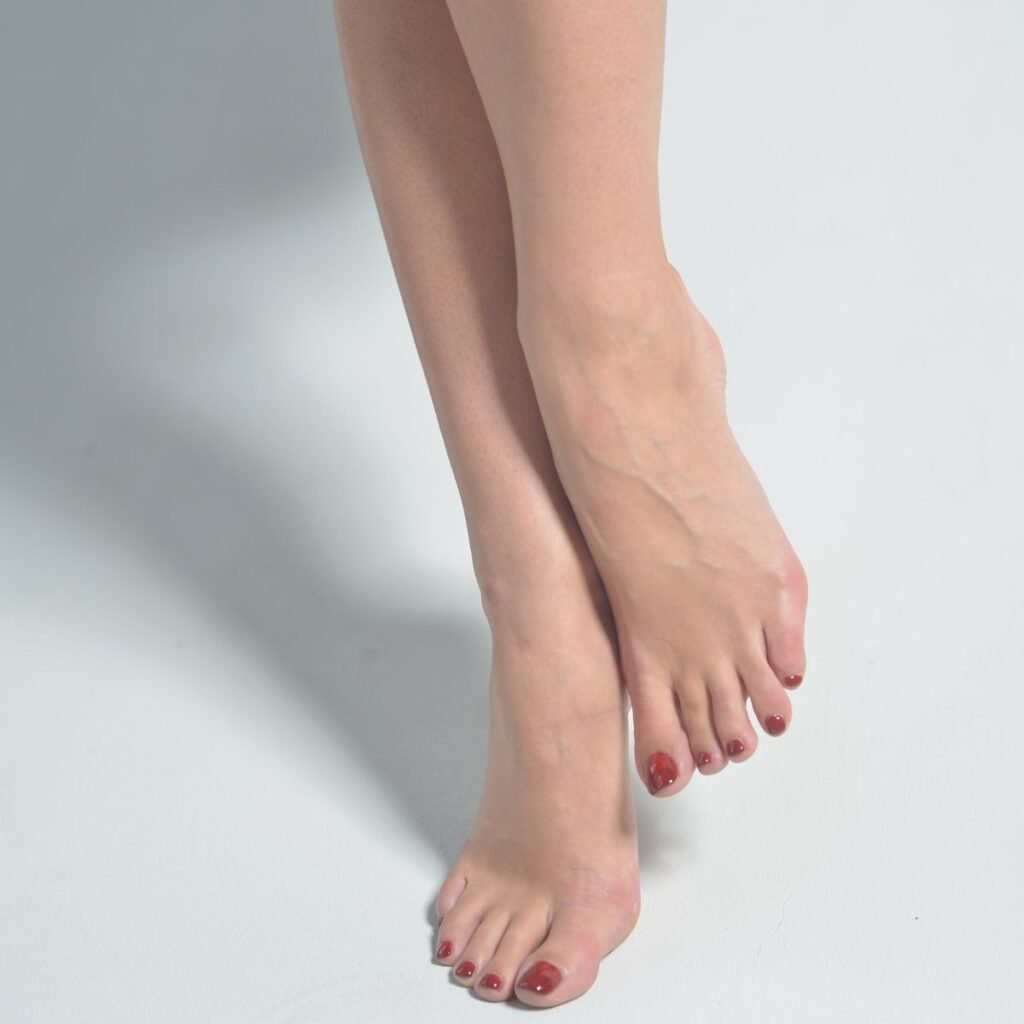 a woman's feet with painted toes