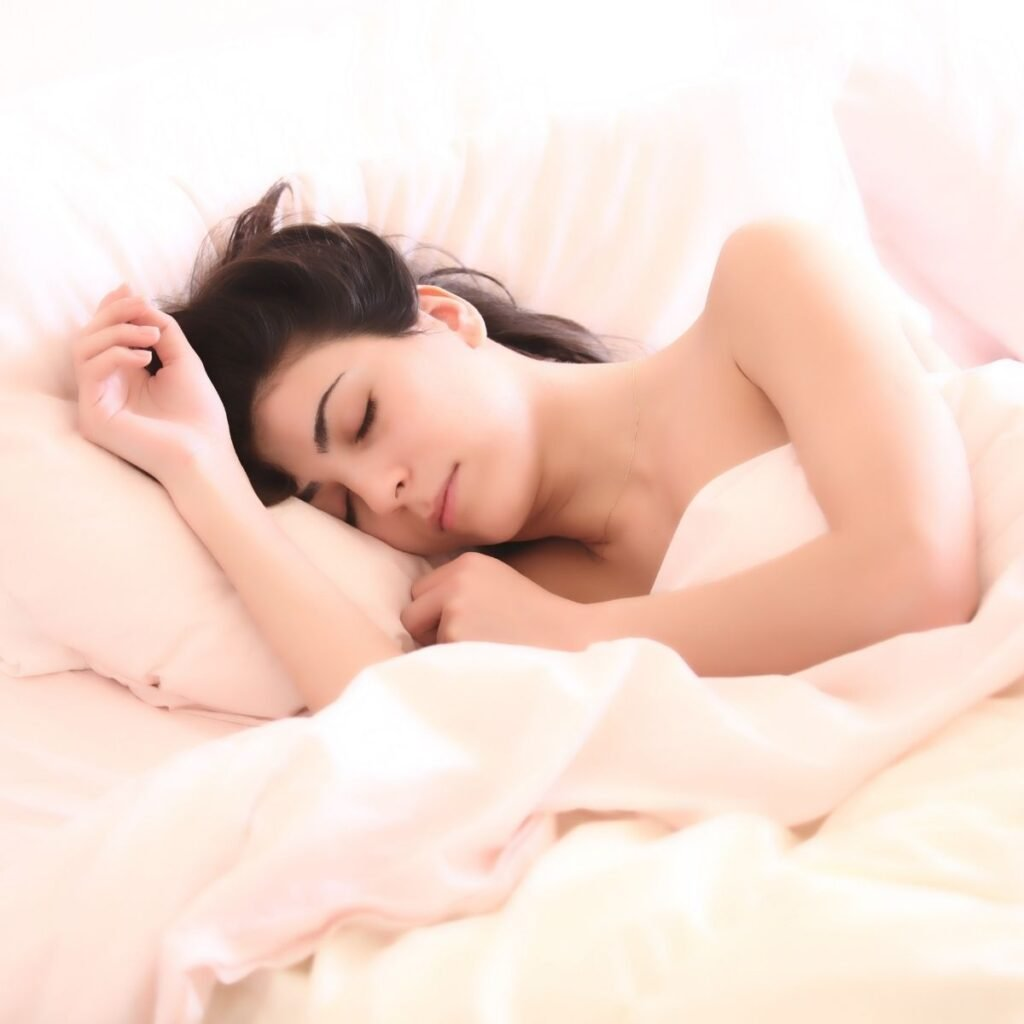 a woman sleeping in a bed