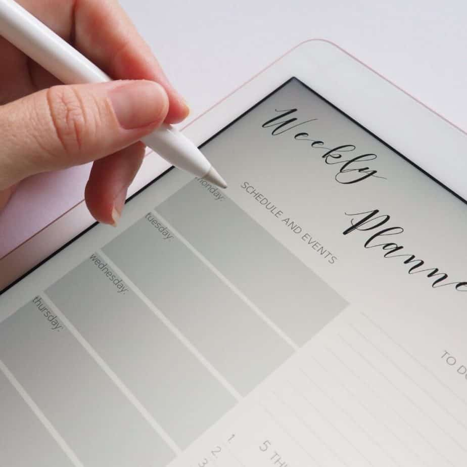 a pen writing in a planner