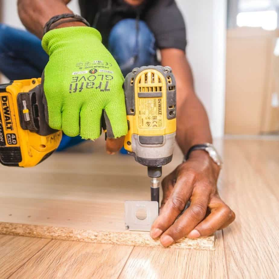 a man using a drill on a piece of wood