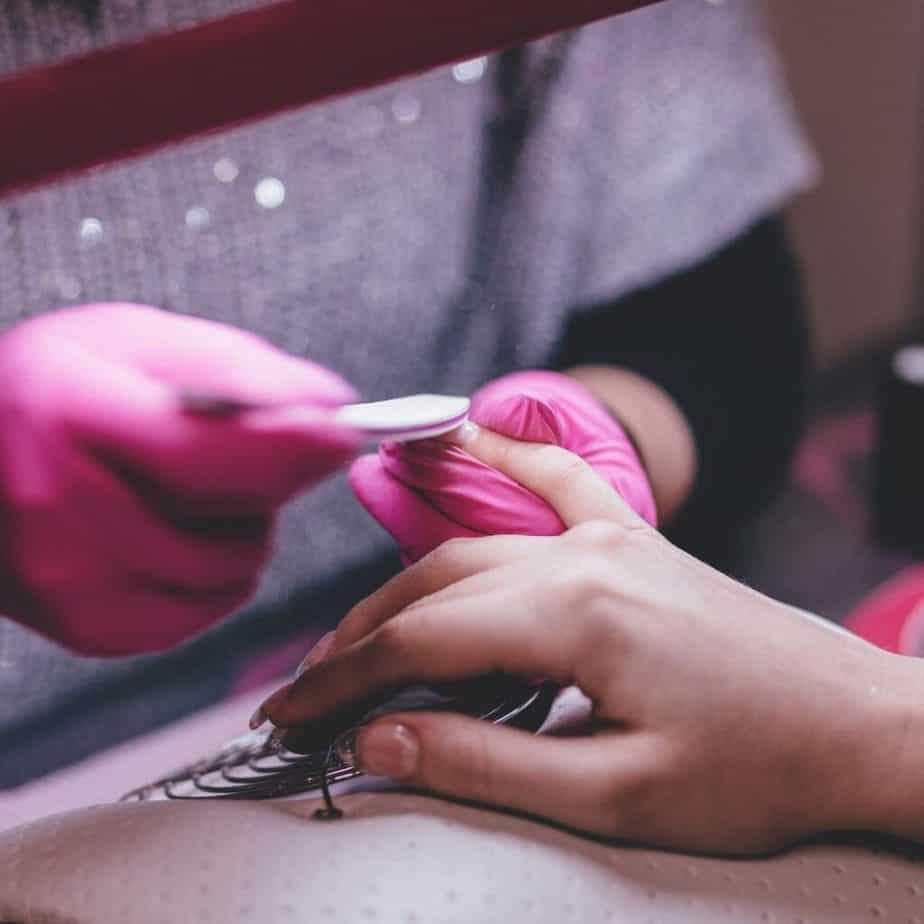 a woman getting her nails done
