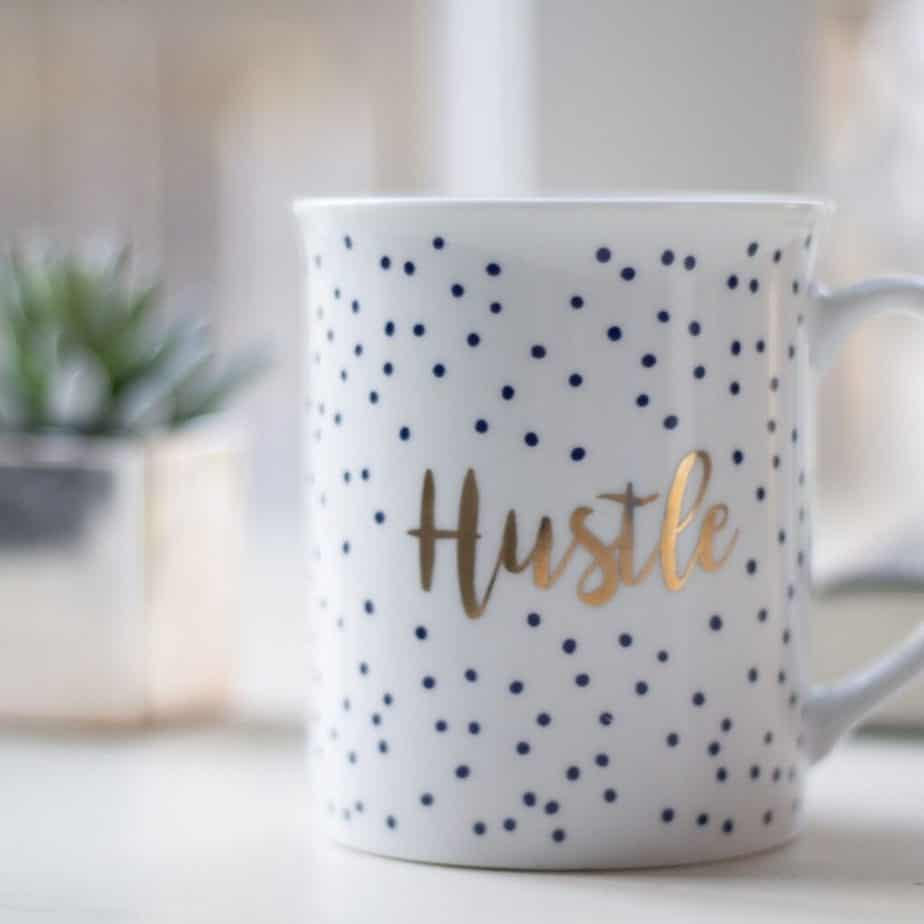 "a coffee cup saying ""hustle"""