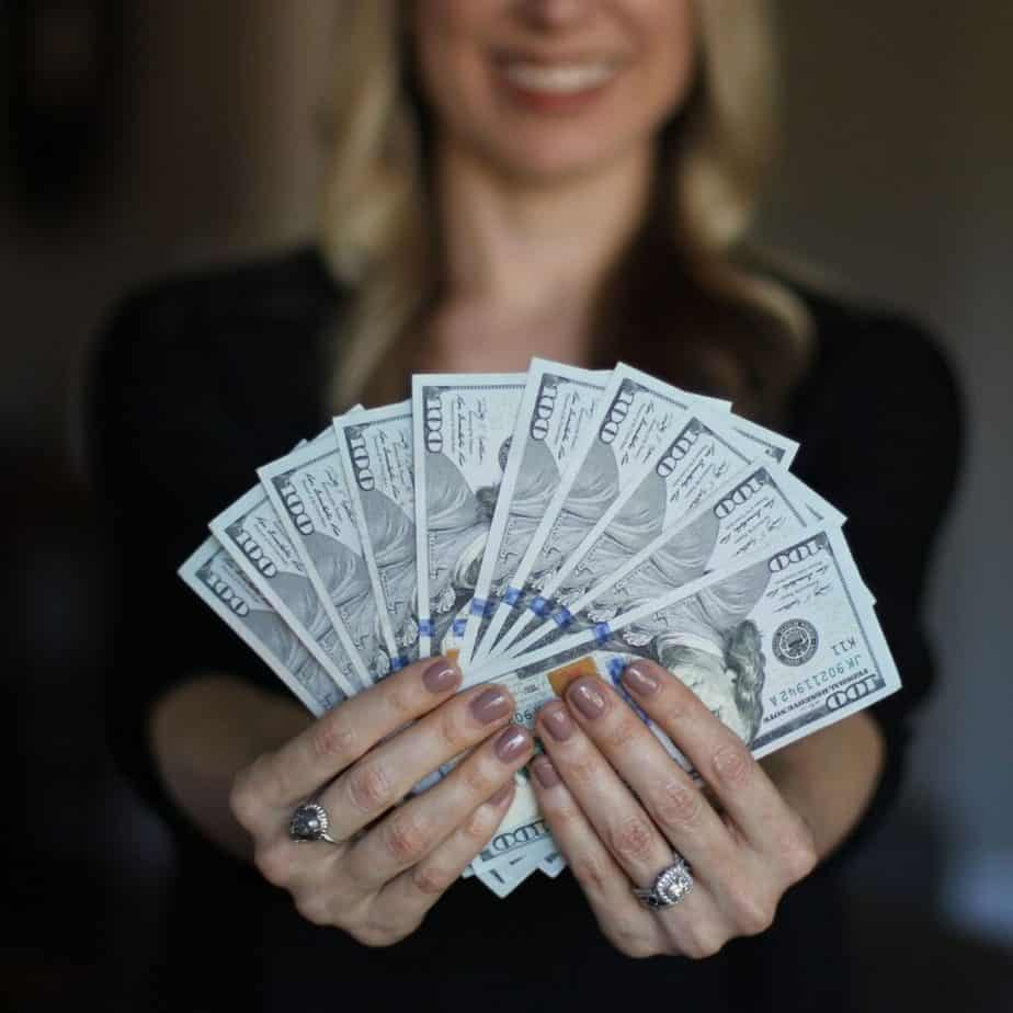 a woman fanning out money