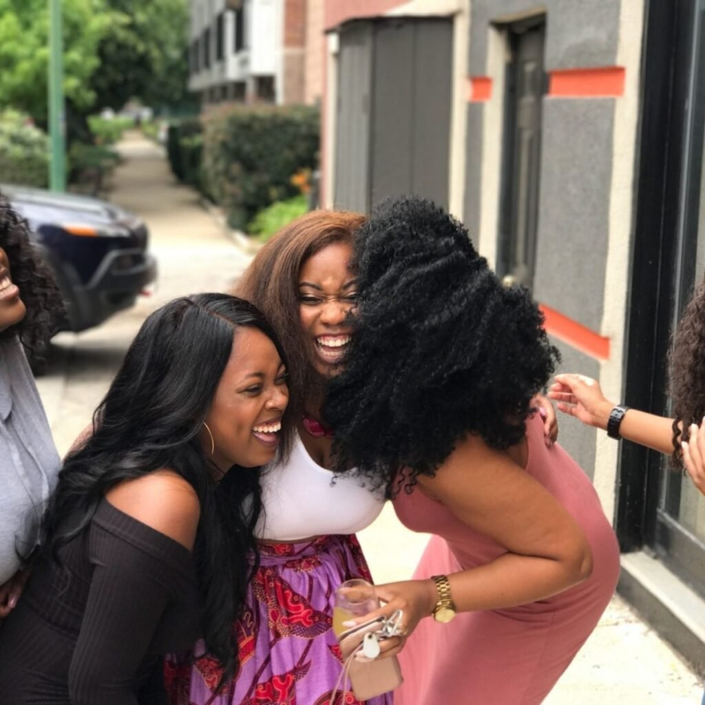 a group of girls laughing on the street