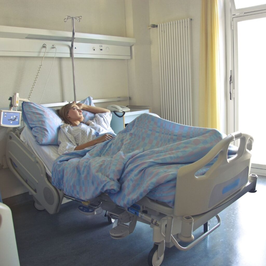 a woman in a hospital bed