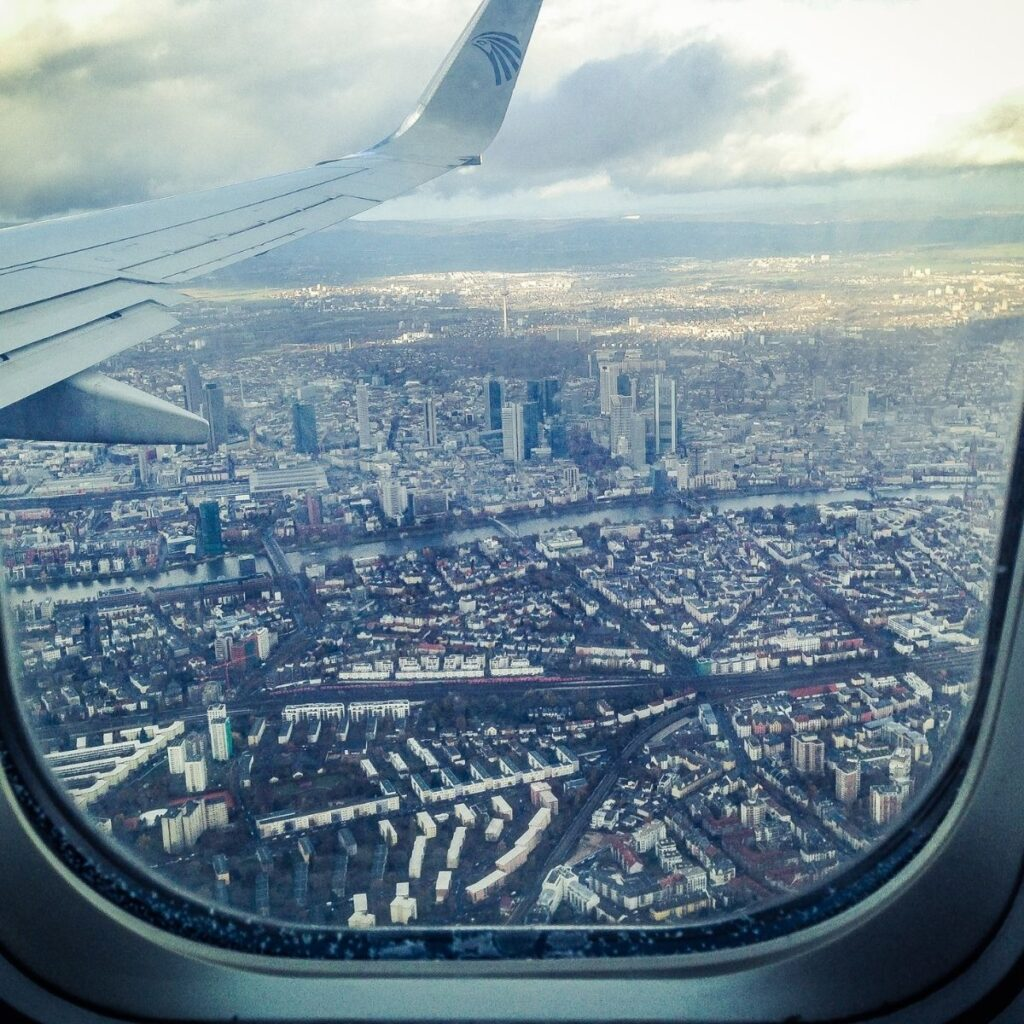 a view of a city out of an airplane window