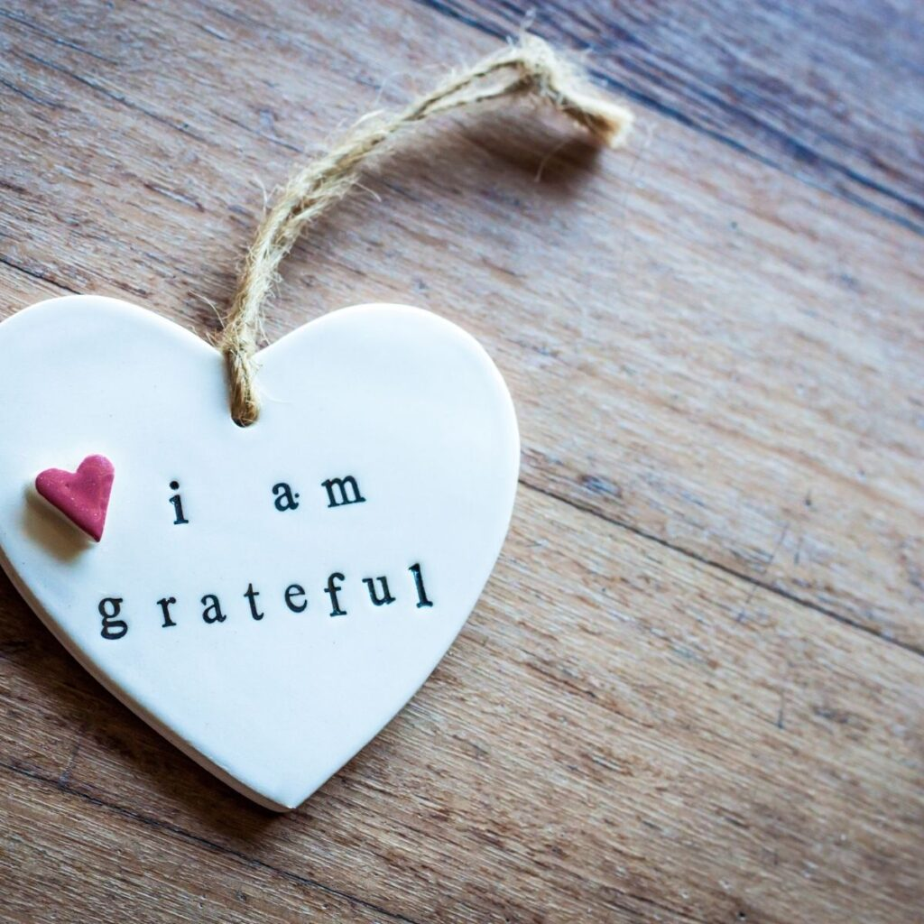 """a white heart with the words"""" i am grateful"""" on it"""