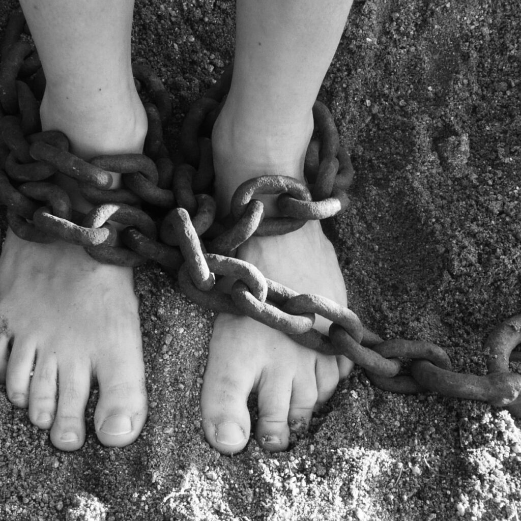 feet with chains wrapped around them