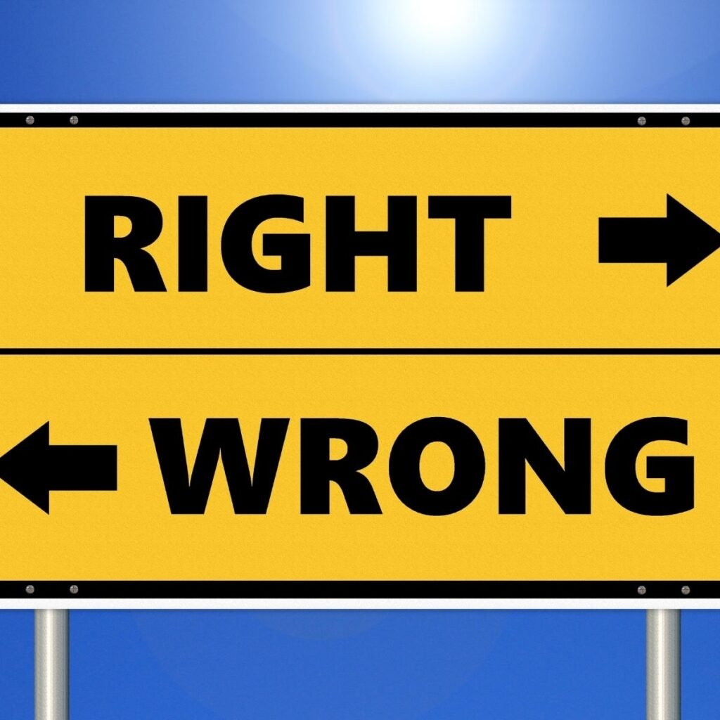 """a sign with the words """"right"""" and """"wrong"""" with arrows pointing different directions"""