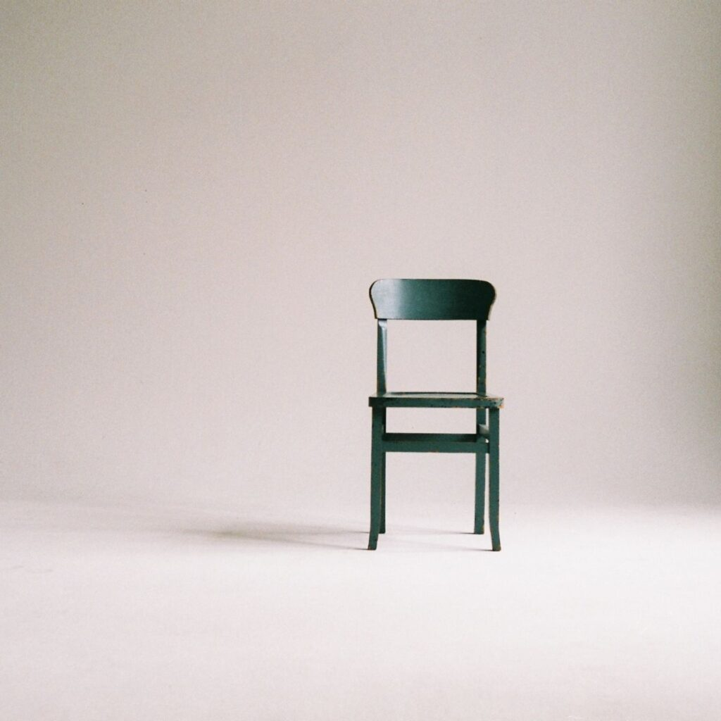 a chair sitting alone in a room