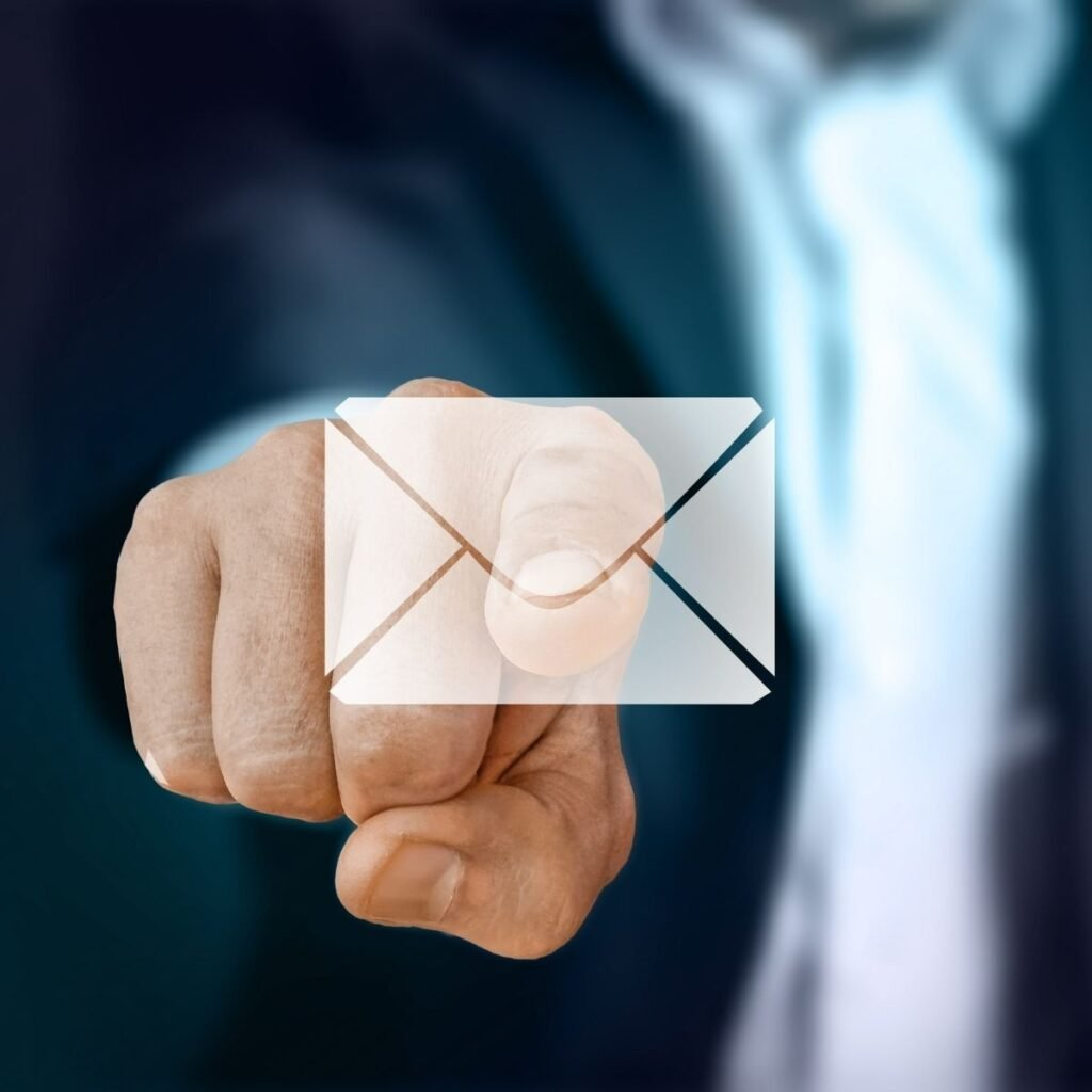 a picture of an envelop with a main pointing at it from the back