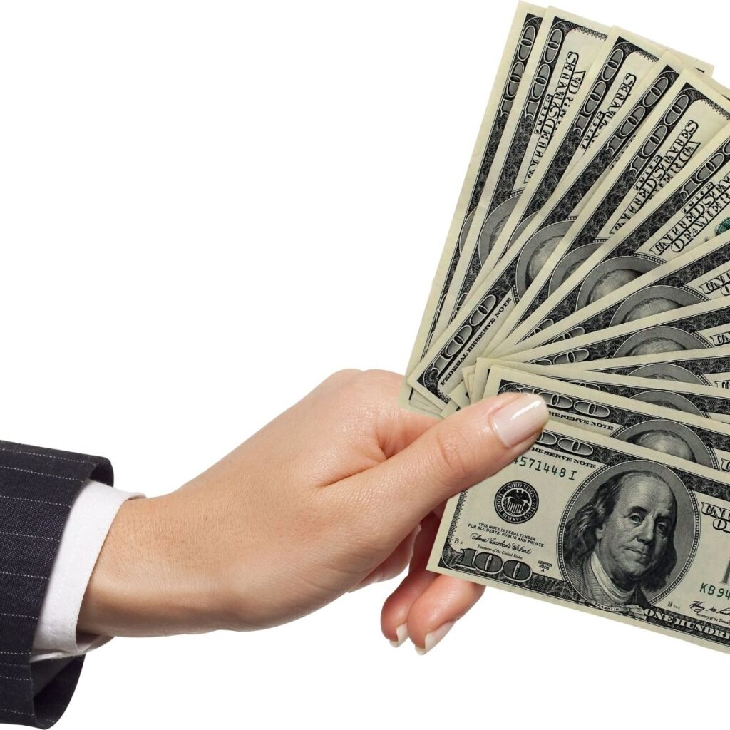 a hand fanning out money against a white background
