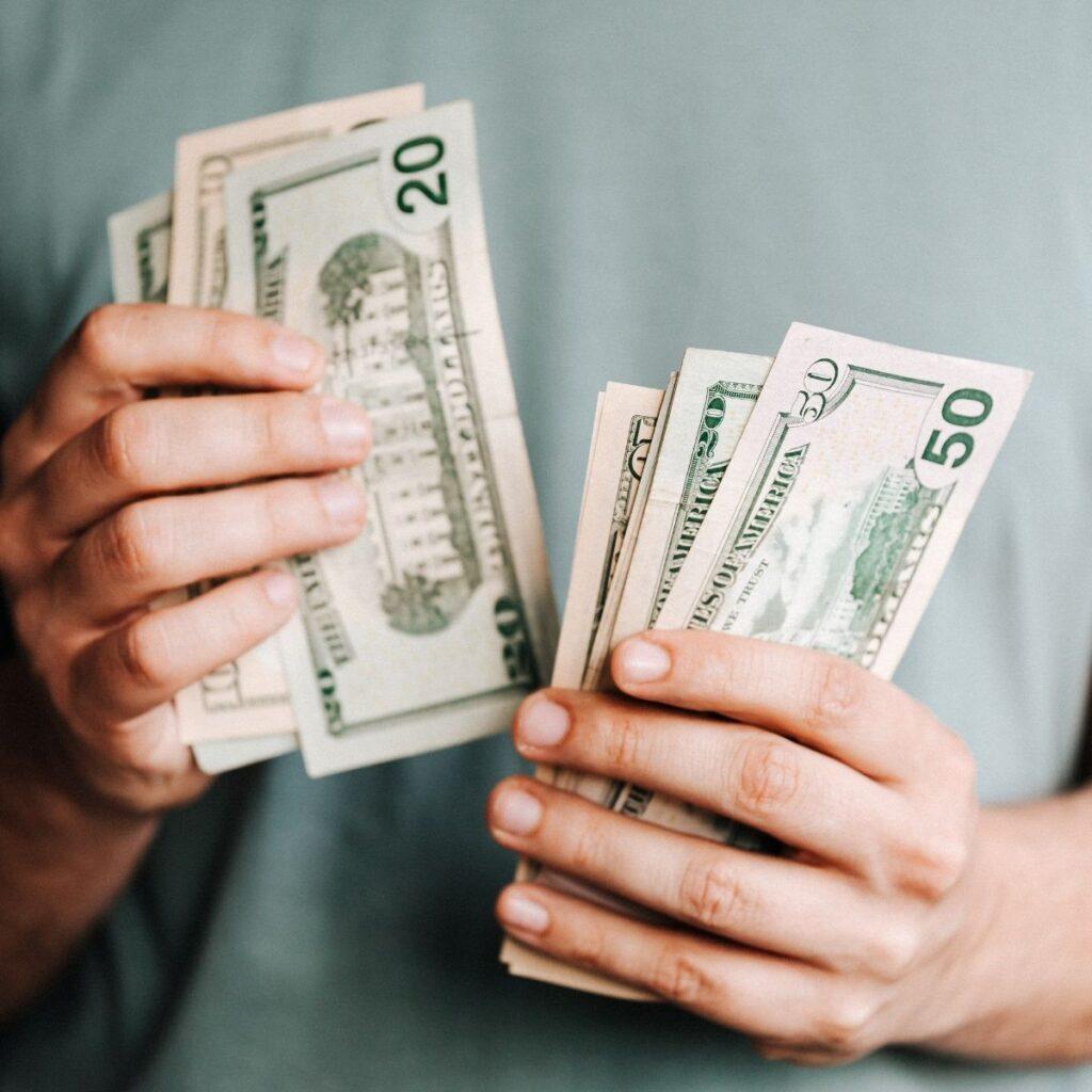 hands holding paper money