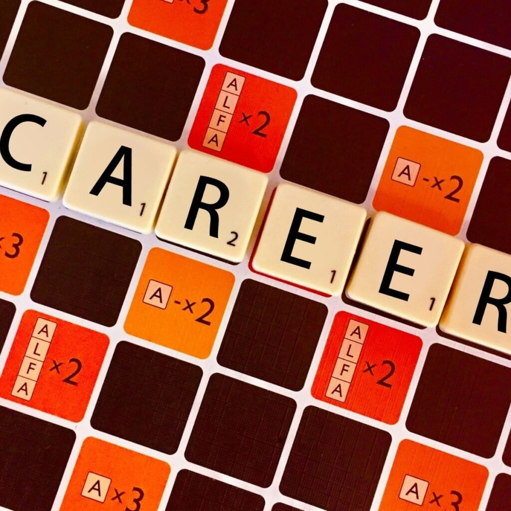 """scrabble pieces on a board spelling """"career"""""""