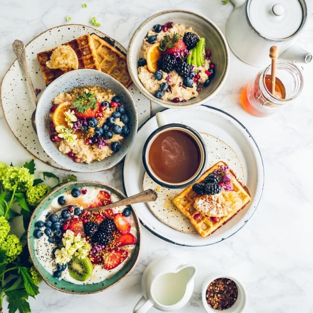 bowls of fruit and oatmeal on a table
