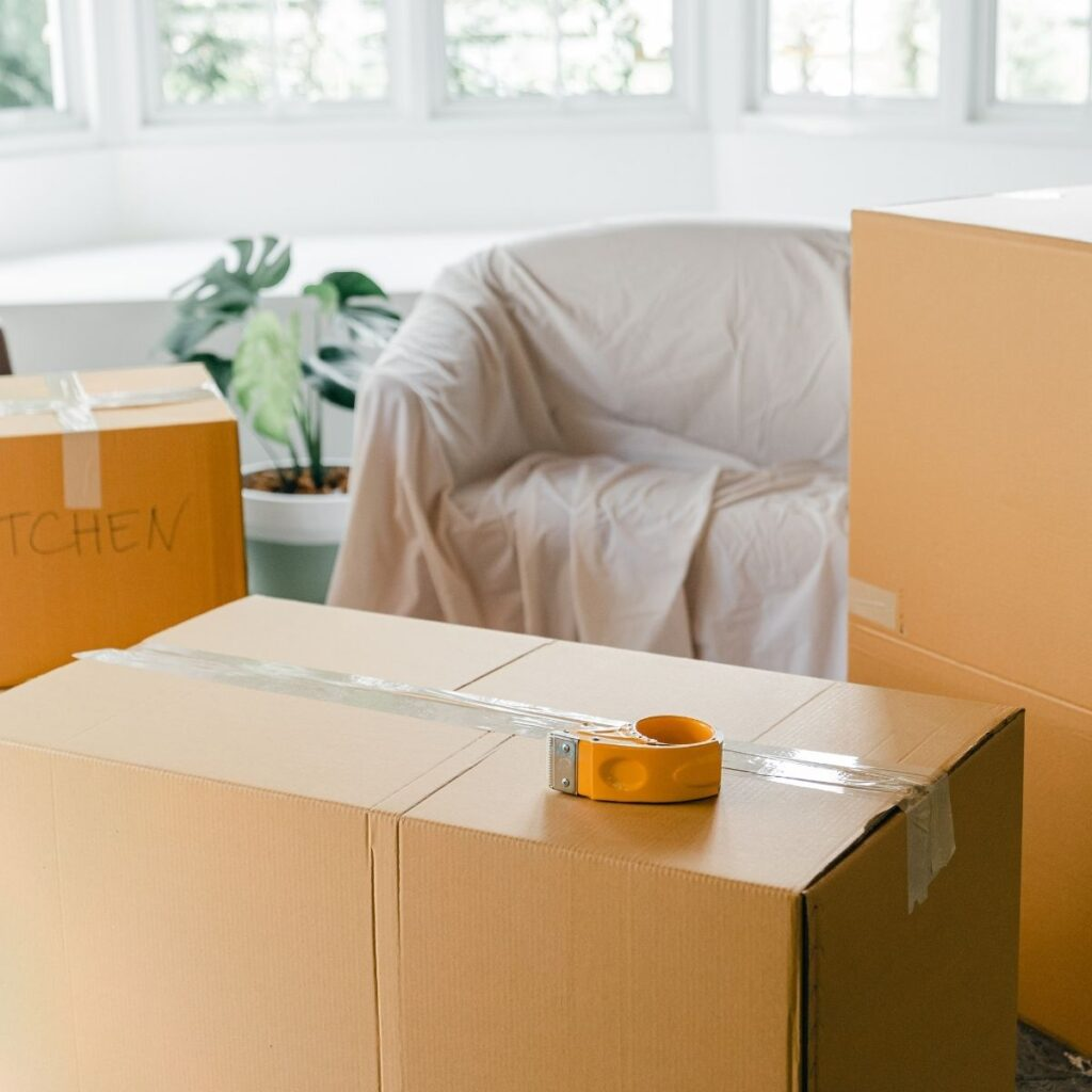 packig boxes in a room secured with tape