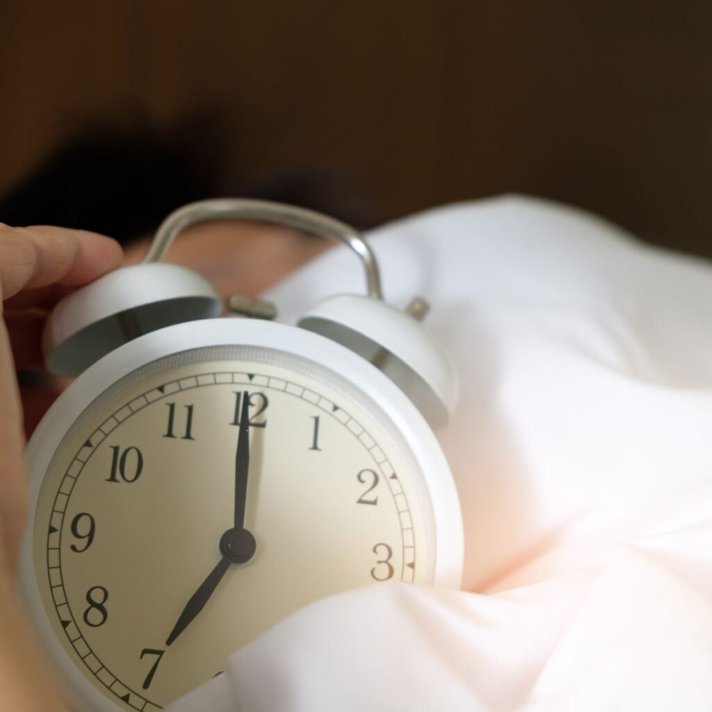 an alarm clock in the sheets