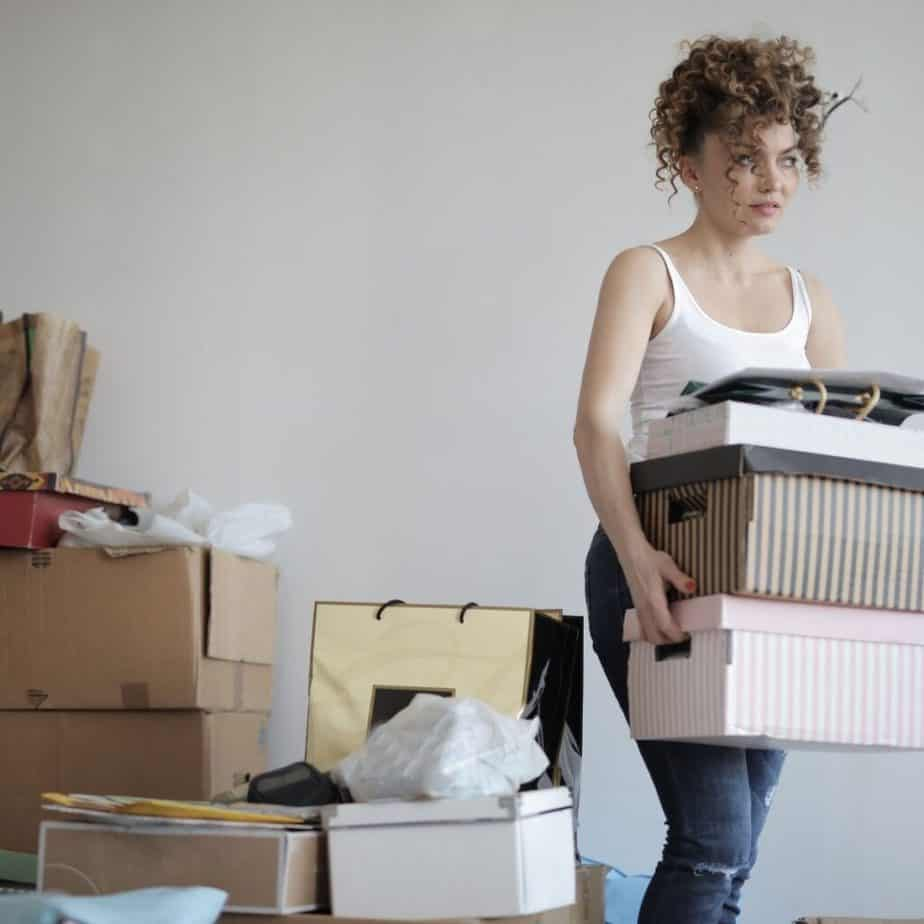 a woman carrying boxes in a room