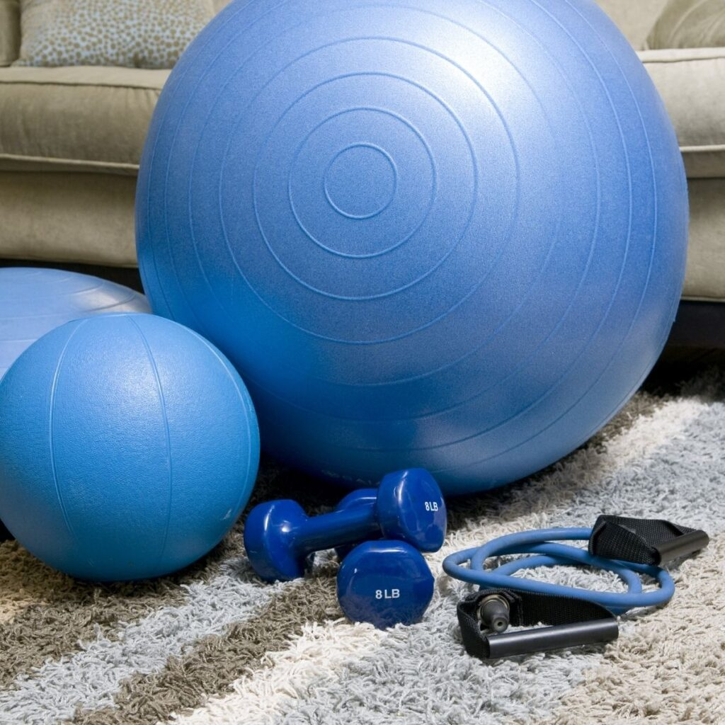 large and small blue exercise balls with weights on the floor