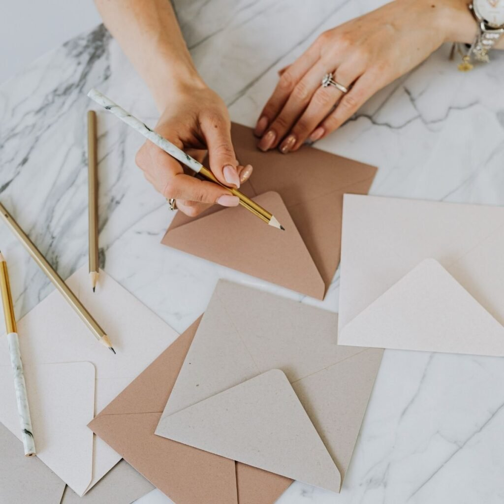 hands writing on envelopes