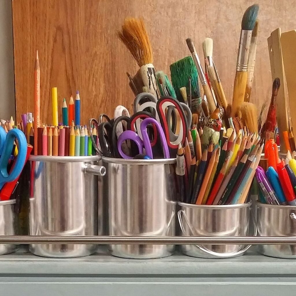 art supplies in jars on a table
