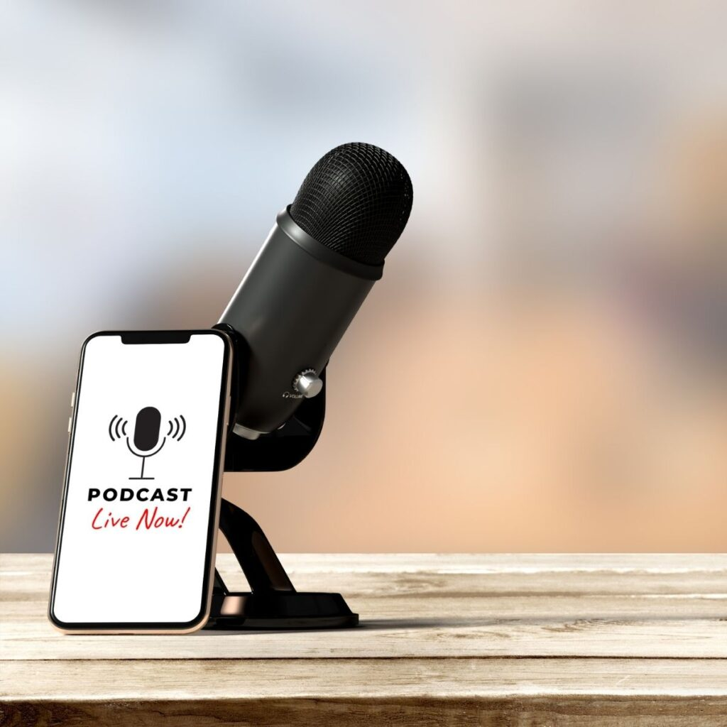a microphone with a smart phone propped up against it