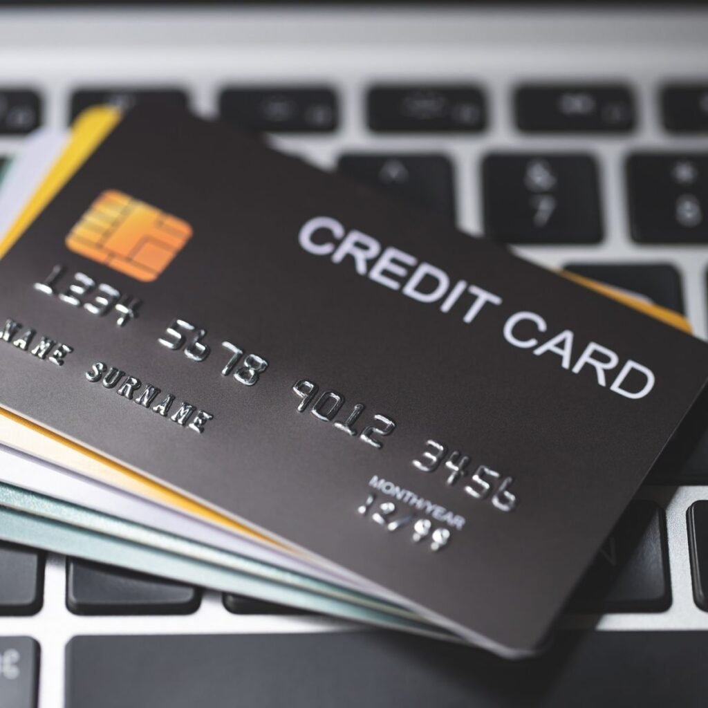 a stack of credit cards on a keyboard